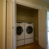 laundry facilities with built in shelving
