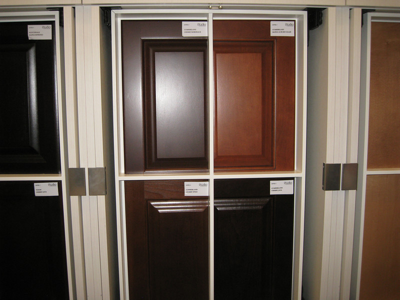 "Standard kitchen Cabinets: Level 4; 42"" maple cabinets full over lay, raised panel cabinets with 4"" crown molding and cabinet hardware."