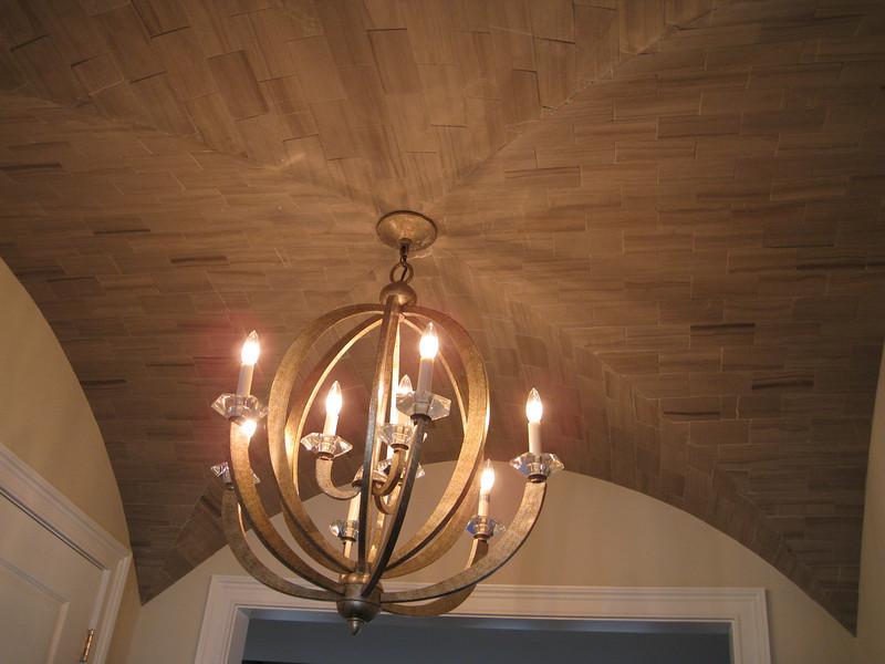 Tiled ceiling in vestibule outside of 1st floor powder room