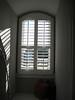 Window in bonus room with plantation shutter