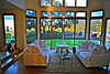 """Lower great room and backyard/Santa Monica Mountain Range views.  """"See through"""" window shades (partially drawn in this photo) allow you to still see the view when you need to close them to soften the sun's rays. They are on all windows in dining room, great room, and den."""