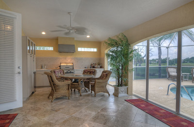 Enclosed lanai with summer kitchen