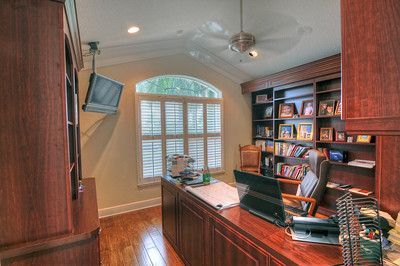 24_Den-office with the following matching built-ins; Murphy bed,  bookshelves, desk, and file cabinets