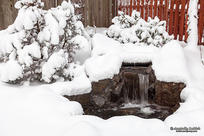 Snow covered outdoor water feature  after US northwest winter storm.