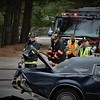 Westford firefighters standby, hoses ready, as one of two cars are removed from crash on Littleton Rd (Rt. 110)<br /> Sun Photo/Mike Higley