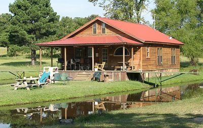 "Taken with my Bigma Lens. ""The Cajun Hide Out"" The Cajun Hide Out has two bedrooms downstairs, with a Queen bed and a Full bed, and two hideabeds in the Living Room.  In addition, it has a small loft upstairs for the children, with a Full bed and a Twin bed, two small fold out beds, a private bathroom, and a TV/VCR. For more info, click on above URL."