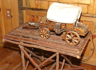 Taken with my Tamron 17-35 f/2.8-4 Lens. A Covered Wagon nightstand. This is in the above Bedroom. It lights up! Neat, huh!