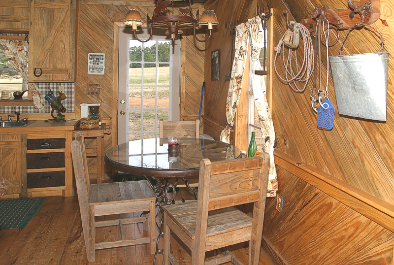 Taken with my Tamron 17-35 f/2.8-4 Lens. The eatin area.  The Table was made from an old Wagon Wheel and Horseshoes for legs.