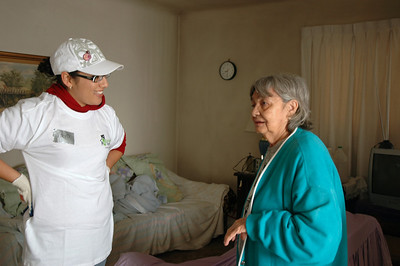A volunteer chats with the homeowner.
