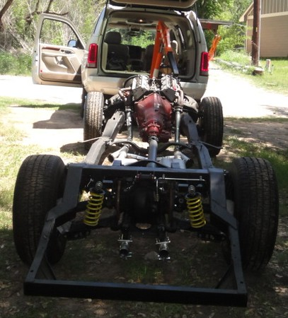 """Chassis pretty much done, rolling it back under the body. See """"building the frame"""" gallery."""