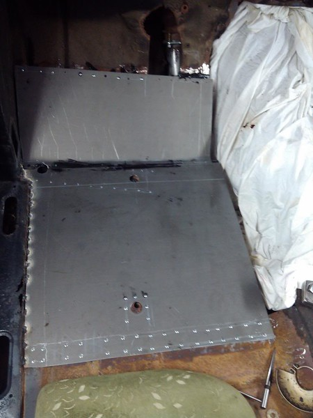 """Driver's side repair panel, pop riveted to """"good"""" floor and welded to edge."""