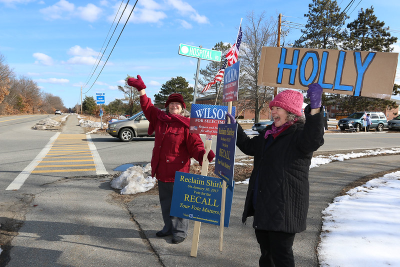 Shirley recall election was held on Monday January 30, 2017 at Town Hall. Waving to motorist as they drive by on Front Street is Janice Snow and Marie Elwyn. SUN/JOHN LOVE