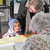 Shirley recall election was held on Monday January 30, 2017 at Town Hall. James Roy, 3, chats with election worker Jean Schubert as his grandmother Susan Johnston check out after filling her ballot at the recall. SUN/JOHN LOVE