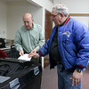 Shirley recall election was held on Monday January 30, 2017 at Town Hall. Election worker Bill Oelfki helps Marc Paris as he cast his ballot at the recall. SUN/JOHN LOVE