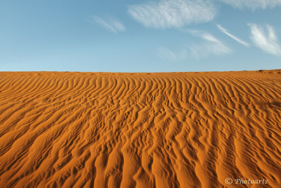 """Sand Ripples to the Sky"" Early morning sun rays light up the ripples on a sand hill in remote UAE desert. #12111398  © Payam Nashery - Photoarts"