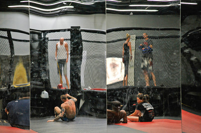 "PANEL MIRRORS INSIDE JACKSON'S MMA, PICTURED ARE UFC'S KEITH JARDINE, SOON-TO-BE WORLD CHAMP JOHNNY ""BONES"" JONES, WORLD CHAMP BOXER HOLLY HOLM, & RESPECTED TRAINER MIKE WINKLEJOHN, 2011"