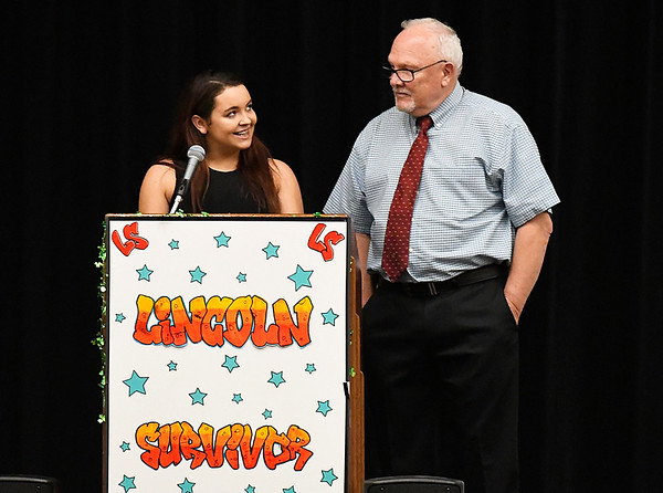 Heather Brown glances as Lincoln Academy principal, Jarry Hill, during her speech Senior Appreciation Night Tuesday May 16, 2017. (Billy Hefton / Enid News & Eagle)