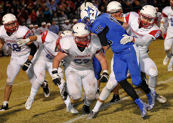 Hennessey's Zane Hugaboom is stopped by Chisholom's Cooper Savage Friday November 6, 2015 during the Longhorns 15-7 win to clinch the district championship. (Billy Hefton / Enid News & Eagle)
