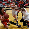 NOC Enid's Sarah Garvie and Dossou Ndiaye pressure NOC Tonkawa's Whitney Metker Thursday February 9, 2017 at the NOC Mabee Center. (Billy Hefton / Enid News & Eagle)