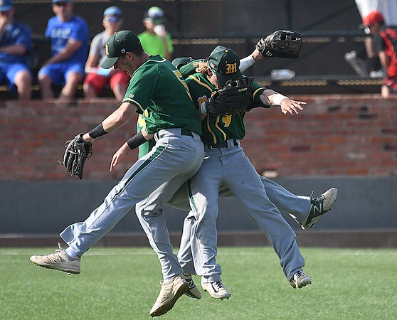 Mercer outfielders. Dan Shane, Sean McGeehan and Nick Dabrio, celebrate the Viking's win over Lansing CC during the 2017 NJCAA DII World Series at David Allen Memorial Ballpark June 1, 2017. (Billy Hefton / Enid News & Eagle)