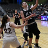 Pond Creek-Hunter's Tyra Peck puts up a shot against Garber's Macy Swart during the class A area consoluation finals February 25, 2017 at the Central National Bank Center. (Billy Hefton / Enid News & Eagle)