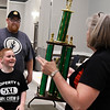 Travis Clark and his son, Cooper, walk up to get the Grand Champion trophy from Donna Patocka during the awards ceremony for the 12th Smokin' Red Dirt BBQ Saturday April 22, 2017 at the Central National Bank Center. (Billy Hefton / Enid News & Eagle)