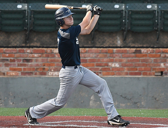 Enid Plainsmen, Koby Hudson, connects on a base hit against the OKC Indians during the opening day of the Connie Mack Regional Qualifing Tournament at david Allen Memorial Ballpark Wednesday June 14, 2017. (Billy Hefton / Enid News & Eagle)