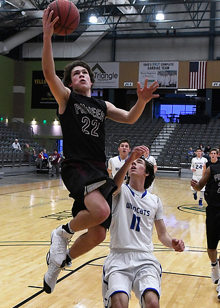Pioneer's Chris Faw Faw gets by Jacob Bowling Covington-Douglas for a layup during the first round of the 93rd Skeltur Conference Basketball Tournament Tuesday January 17, 2017 at the Central National Bank Center. (Billy Hefton / Enid News & Eagle)