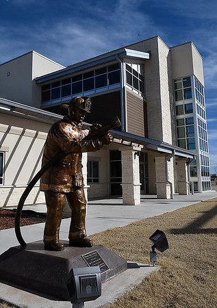 """The statue """"Every Day a Hero"""" by Colette Pitcher stands in front of the new central fire station in Woodward. (Billy Hefton / Enid News & Eagle)"""