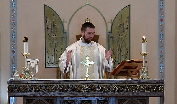 Fr. Kelly Edwards celebrates mass at St. Francis Xavier Catholic Church Friday July 14, 2017. (Billy Hefton / Enid News & Eagle)
