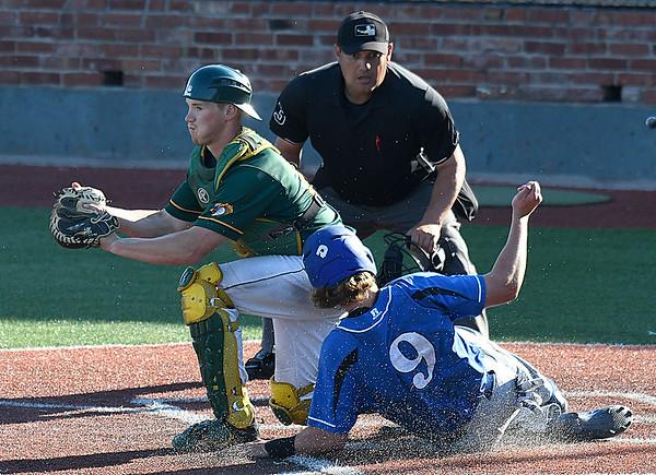 Parkland catcher, Jordyn Muffley, forces out Drew Piscorik of Pitt CC during the 2017 NJCAA DII World Series at David Allen Memorial Ballpark Monday May 29, 2017. (Billy Hefton / Enid News & Eagle)