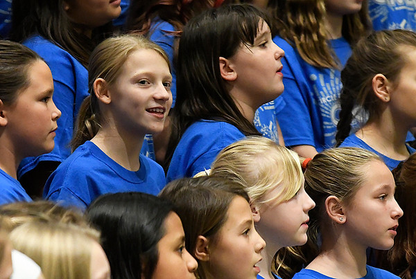 A girl glances at the audience during the 2017 Region B Circle the State with Song Choral Festival Tuesday January 10, 2017 at the Convention Hall inside the Central National Bank Center. (Billy Hefton / Enid News & Eagle)