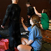 """Brenna Bushman and Madi Wilson paint cast members costumes for the Gaslight Kids' Drama Camp production of the """"Lion King Kids"""" at the Gaslight Theater. (Billy Hefton / Enid News & Eagle)"""