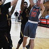 NOC Enid's Ty Lazenby shoots over a trio of Redlands CC defenders Thursday January 12, 2017 at the NOC Mabee Center. (Billy Hefton / Enid News & Eagle)