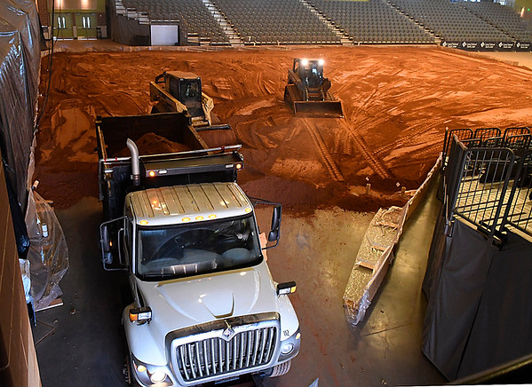 Dirt is hauled into the Central National Bank Center as it is transformed in a bull riding arena for the CBR Battle on the Great Plains event scheduled for Saturday January 7, 2017. (Billy Hefton / Enid News & Eagle)