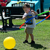 Rowan Hallam tries the hula hoop during the Bee Invasion Saturday May 13, 2017 on the Garfield County Courthouse lawn. (Billy Hefton / Enid News & Eagle)