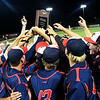 Kankakee CC players raise the national championship trophy defeating Mercer CC to win the 2017 NJCAA DII World Series Friday June 2, 2017 at David Allen Memorial Ballpark. (Billy Hefton / Enid News & Eagle)