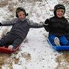 Julian and Jimmy Tapia-Fuerte sled down the side of the north Van Buren overpass Friday January 6, 2017. (Billy Hefton / Enid News & Eagle)