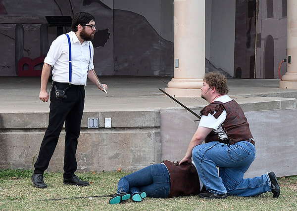 """Ben Ezell (left) and Matthew Houston rehearse for the Shakespeare in the Park production of """"Titus Andronicus"""" Tuesday June 20, 2017 at Government Springs Park. (Billy Hefton / Enid News & Eagle)"""