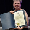 Julie Baird holds a citation from Oklahoma Lt. Gov. Todd Lamb upom her retirement as executive director Leonardo's Children's Museum during the annual awards dinner Thursday March 9, 2017 at the Central National Bank Center. (Billy Hefton / Enid News & Eagle)