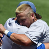 Murray State's Troy Black and Greg Greenwood embrace following a 12-7 loss to Phoenix CC Monday May 29, 2017 at David Allen Memorial Ballpark eliminating the Aggies from the 2017 NJCAA DII World Series . (Billy Hefton / Enid News & Eagle)