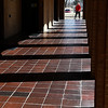 Logan Rauh begins to walk through the shadows of Zollars Memorial Library Friday February 10, 2017. (Billy Hefton / Enid News & Eagle)