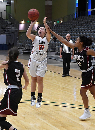 OBA's Bretta Stibel shoots over Watonga's Lu McKinsey and Allie Baker Saturday February 4, 2017 during the Downtown Basketball Festival at the Central National Bank Center. (Billy Hefton / Enid News & Eagle)