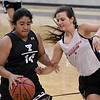OBA's Emily Long defends Timberlake's Gady Solis during a team basketball camp at Pioneer High School Wednesday June 7, 2017. (Billy Hefton / Enid News & Eagle)