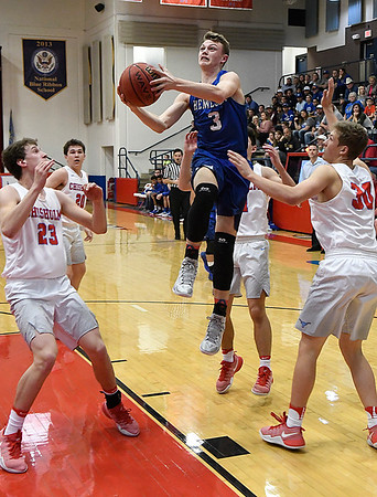 Hennessey's Matthew Smith drives to the basket between Chisholm's Colton Wichert and Alex Angleton during the district tournament Saturday February 18, 2017 at Chisholm High School. (Billy Hefton / Enid News & Eagle)
