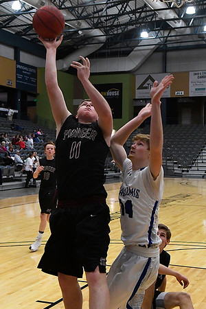 Pioneer's Mikail Williams puts up a shot against Chris Henderson of Waukomis during the third place game of the 93rd Skeltur Conference Basketball Tournament Friday january 20, 2017 at the Central National bank Center. (Billy Hefton / Enid News & Eagle)