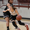 OBA's Devon Hawk dribbles against Timberlake's Jayden Dillon during a team basketball camp at Pioneer High School Wednesday June 7, 2017. (Billy Hefton / Enid News & Eagle)