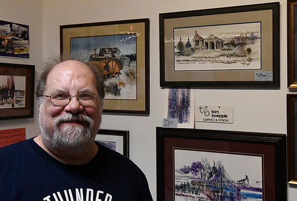 Tom Boepple stands next to some of his watercolor paintings at the Enid Art Association Gallery inside Oakwood Mall Friday June 8, 2017. (Billy Hefton / Enid News & Eagle)