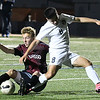 Enid'sMarcos Arambula gets tangled up with an Owasso defender Friday April 14, 2014 at D. Bruce Selby Stadium. (Billy Hefton / Enid News & Eagle)