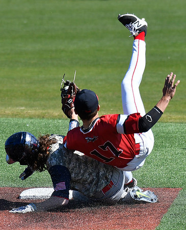 Northland's Aaron Berzinski upends NOC Enid's T.J. Black after being tagged out trying to steal second Friday March 3, 2017 at David Allen Ballpark. (Billy Hefton / Enid News & Eagle)